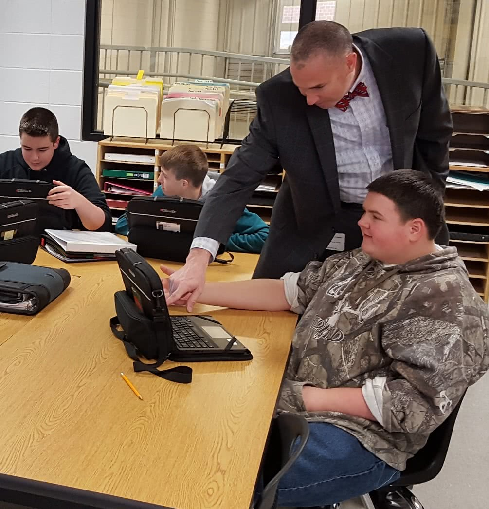 Dr. Asbill assisting student at computer