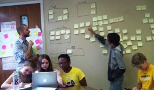 Adam Scimone with students at computer and white board