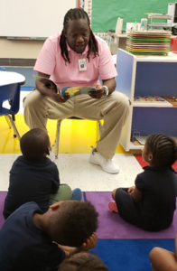 Sanders reading to kids